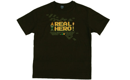 "Zelda 2 ""Real Hero"" shirt. The King of Games has reprinted four of its classic Zelda designs for its 10th anniversary – an event also being marked by an exhibit in Nagoya, with tote bags and buttons. Ah, well, I'm used to pining for KOG stuff by now… Buy: Legend of Zelda: Skyward Sword Find: Nintendo DS/3DS release dates, discounts, & more  See also: More King of Games shirts"