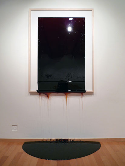 WALLPIECE I-III, 2009. burnt sugar (liquid), Maple, MDF, swimmingpool coating.80 x 60 x 3,5 cm.35 x 45 x 3 cm.120 x 90 x 4 cm.An object whose volume consists of viscid burnt sugar, melted due to air moisture while being another work of art. Put on the wall immediately before the opening reception, the content slowly starts to flow out. exhibit view  Installation by Jonas Etter.