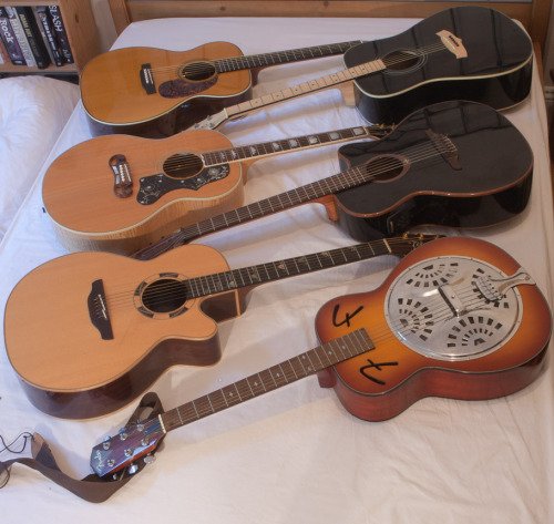guitar-porn:  Acoustic Guitars by the bed-load. Chris Thomas (AKA jammy-git) sent in this beautiful selection of acoustic guitar porn reading from top left to right; Martin Eric Clapton Signature, Tanglewood, Gibson J-200 Emmy Lou Harris, LAG nylon string,  Takamine Santa Fe (Ltd Edn) and a Fender Resonator.