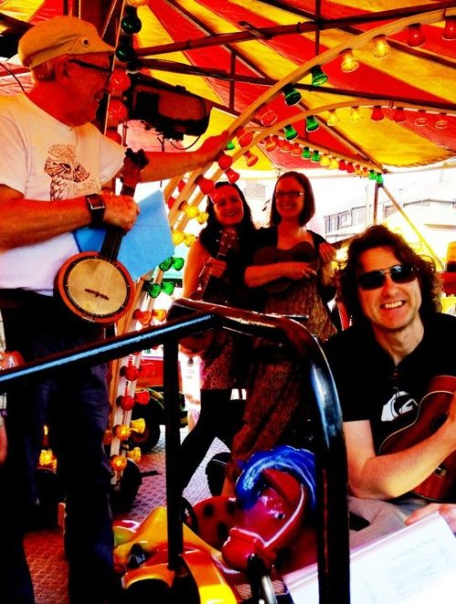 Levy Uke Up hijack the merry-go-round at Levenshulme Market. I got the motorbike, in case you were wondering - no Barbie car for me! Photo credit: Andrew Sherry