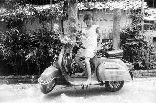 a little girl with vespa on Flickr.