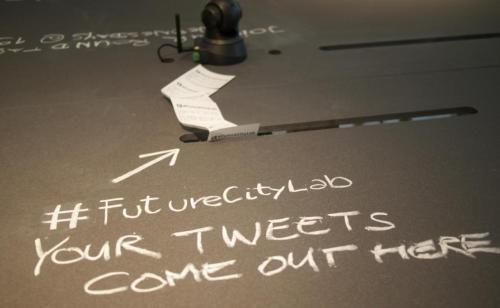 "opensimsim:  We helped develop a tweet printer for the FutureCityLab exhibition. Just send your tweets: QUESTIONS ABOUT THE FUTURE, YOUR IDEAS, YOUR CONCERNS, YOUR FORESIGHT mentioning ""#FutureCityLab"" or writing to @FutureCityLab  我們協助FutureCityLab展覽設計出Twitter訊息印表機,只要發送Twitter訊息至@FutureCityLab,或在訊息內加註#FutureCityLab標籤,無論是有關未來的問題、想法、疑慮、遠見,都會在此列印出來。"