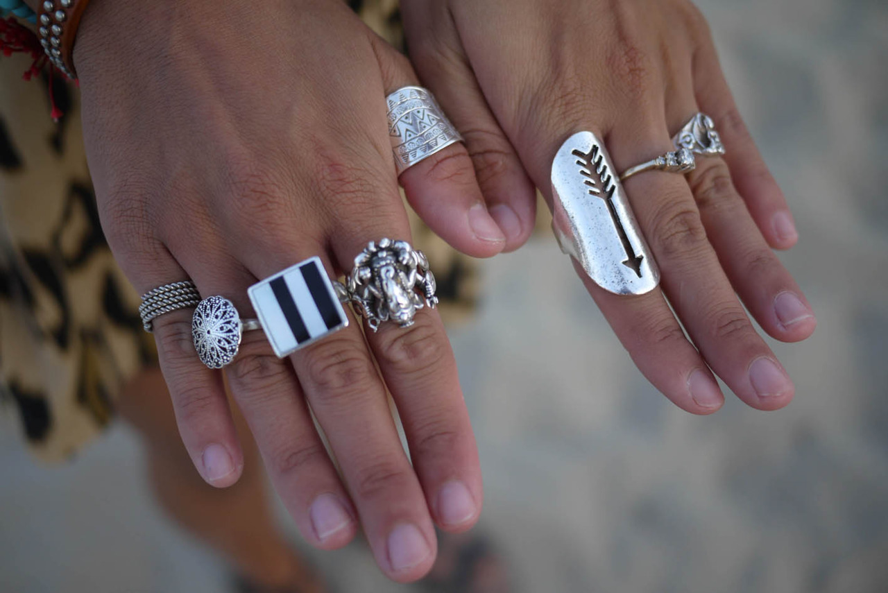 wgsn:  Silver jewelery with a global traveler feel as seen on Bora-Bora beach Ibiza