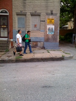 Jaime Rojo and Martha Cooper on the hunt in Baltimore for Street Art, graffiti, pigeon trainers…. LaBrona on the right.