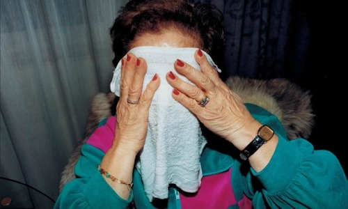 Grandma Covers Her Face, Elinor Carucci, 1994