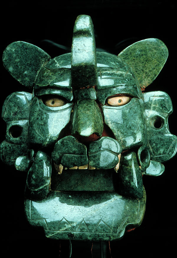 Zapotec jade and shells mask, ca. 200 BC - 100 AD, Monte Alban, Mexico. Photography © Jorge Pérez de Lara.  Even though many scholars maintain that this is a bat mask, many of its features point towards its identification as a feline, possibly a jaguar. If this is correct, it may be associated with power and royal lineages. Regardless of its identification, it is one of the most valuable treasures ever recovered from Monte Albán. - mesoweb.com