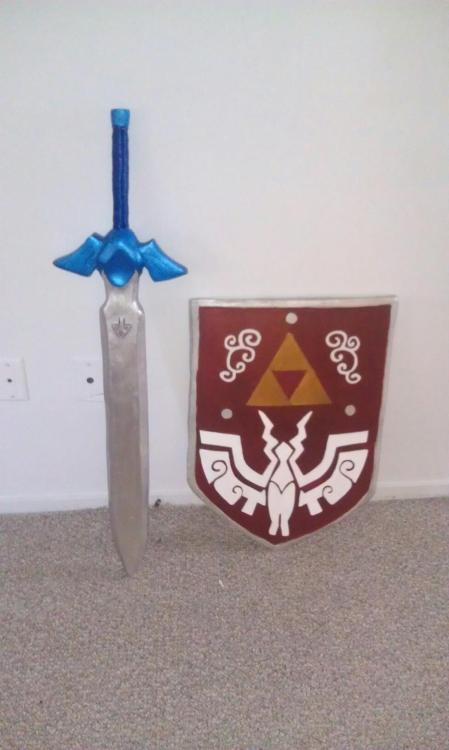 OMG I'm an so close to being done with my Master Sword and Hero's Shield. I still need to touch up some places and resin cast my gems for the sword and add the piece at the end of the handle and then I need to finish the back of the shield and seal everything.  Next I have to make Nick's Ganondorf swords and costume. @_@. I just really hope I can finish this stuff for ColossalCon. Especailly since I've been putting off finishing my Link cosplay for over a year now. ^_^;;