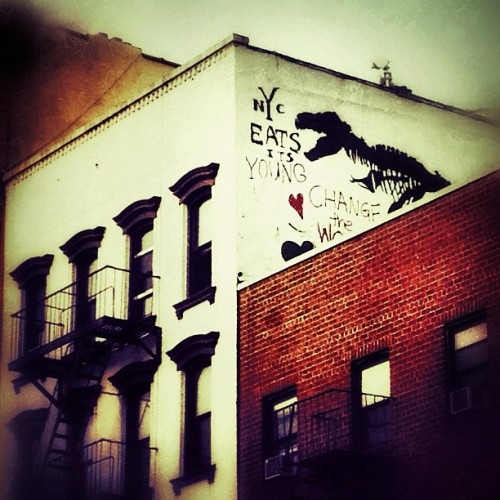 "NYC eats its young. Chomp, chomp! Street art. East Village, New York City. —-  This is my weekly mobile photography post. I hit my one month anniversary of when I first started using Instagram and dabbling in the world of mobile photography a week or so ago. I really never expected to have so much fun with mobile photography!   The community(ies) on Instagram is/are wonderful if you know where to look. I have found so many truly talented artists on there (lots of people involved in surrealism which has blown my mind) and it's probably one of the most interactive and engaging photography hubs currently (aside from some of the other larger traditional social networks). If you stay away from the popular page (although there are some gems to be found there at times), and really explore, you can find real treasures there.  Prior to a month or so ago, I didn't really understand mobile photography. I thought that people were just taking photos and applying the pre-made Instagram filters and that was that. However, I have learned that there are so many quality photo-editing mobile apps out there and an infinite amount of ways you can add your own style to mobile photography just like 'regular' photography. I have also noticed that there is a rather active and stunning world of street photography and documentary photography out there that I would have never come across had I not ventured into mobile photography. And it's so much more than just Instagram. With other photo-sharing networks like EyeEm, StreamZoo and Facebook's venture into its own camera app, the future seems bright for mobile photography.  I am @newyorklens on Instagram (view my feed here).  You can check out some of my Instagram photos on Flickr here. Additionally, you can view my phone photography for sale here.     —-  View this photo larger and on black on my Google Plus page   —-  Buy ""NYC Eats Its Young - East Village - New York City"" Prints here, My mobile photography for sale here, My regular photography for sale here, email me, or ask for help."