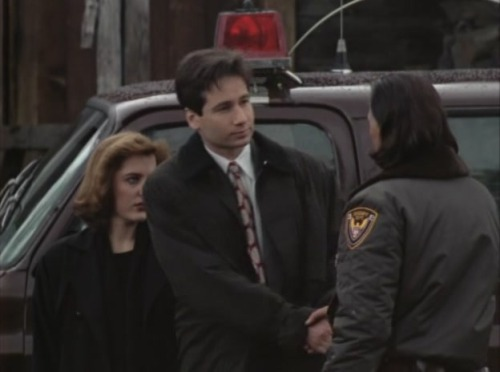 "foxmuldertouchingpeople:  Fox Mulder touching his old colleague Deputy Tommy ""Hawk"" Hill."