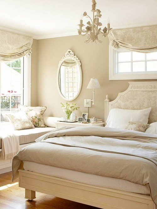 A beautiful example of a neutral-toned bedroom, with a damask headboard and a sunny window seat (via Comfy Cozy Bedrooms)