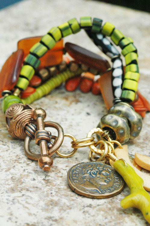 Fiji Charm Bracelet: Exotic Amber, Green, Wood, Bone, Brass and Mixed Media Charm Bracelet