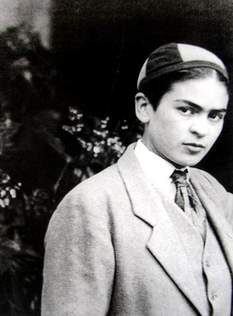 Young Frida Kahlo in a boy's suit & cap