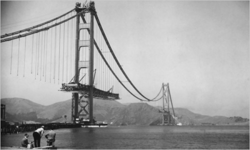 picturethisdate:  On May 27, 1937, the Golden Gate bridge, here seen under construction, opened to pedestrians. (It opened for automobile traffic the next day.) At the time, the bridge was an engineering marvel, having the longest main span of any suspension bridge, a record it held until 1964.