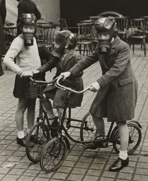 Children on bicycles, wearing gas masks, 1940s Daily Herald Archive