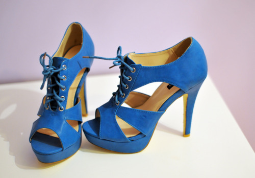 I love the color of these pumps. The laced up detail is cute.