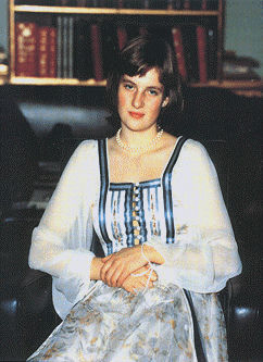 A very young Lady Diana Spencer, pictured at the house's library by her father in 1974.