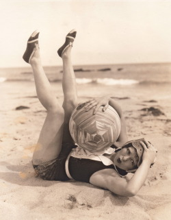 clarabowarchive:  Beauty & the Beach Ball ☆ Clara Bow in her bathing suit at the beach ☆ Original photograph by Otto Dyar ☆ Rubber-stamped on reverse:  CLARA BOW in PARAMOUNT PICTURES Permission is hereby granted for use of this photograph in Magazines and Newspapers Credit to PARAMOUNT PICTURES will be appreciated. Photograph by OTTO DYAR   One of the students at work said I reminded her of Clara Bow. I was flattered as all hell.