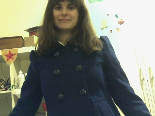 brennanlovesbooth:  This is me in my coat. My webcam was being a bum so I look completely demented.  WELL HOT DAMN. It is so beautiful! As is the model ;)