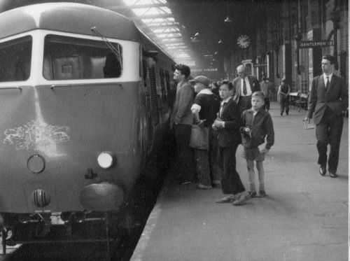 Children waiting to board a Pullman car, Midlands, UK, ca. 1960s.
