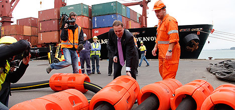 John Key looks at cables.