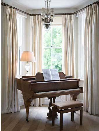 elegant bay window with a piano