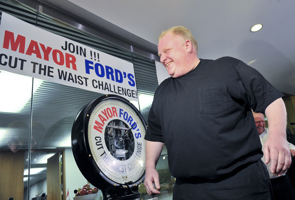 "Thirty-four pounds short of goal, Rob Ford cancels Cut the Waist campaignAfter losing only 16 pounds in five months, Mayor Rob Ford has abandoned his public pledge to lose 50 pounds by June.""I don't care about the weigh-in,"" Mr. Ford said Sunday on his weekly Newstalk 1010 radio show, which he hosts with his brother, Toronto City Councillor Doug Ford. ""I'm not even dieting anymore."" (Photo: Aaron Lynett/National Post)"