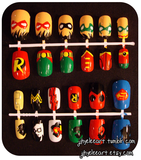 fashiontipsfromcomicstrips:  Manicure Monday: custom Robin nail set & Young Justice nail set, by Jihye Lee. I think that I may need to adorn my nails with tiny domino masks in the near future.