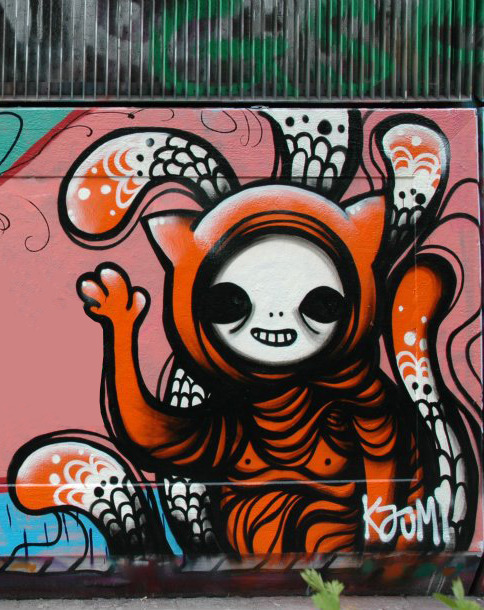 """ mr. Monkey Nipples says hi"" cans on wall -2012"