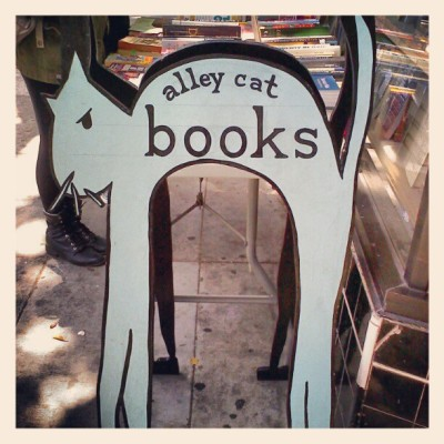 the cat is trying to eat @catolinee's legs #allycatbook #bookstore #cat #sf  (Taken with instagram)