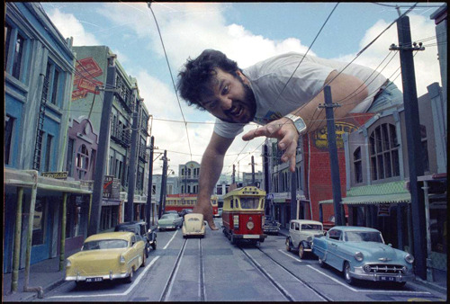 ridleyscotts:  Peter Jackson, with the miniature set reproducing 1950s Newtown from the film 'Braindead' [1992]