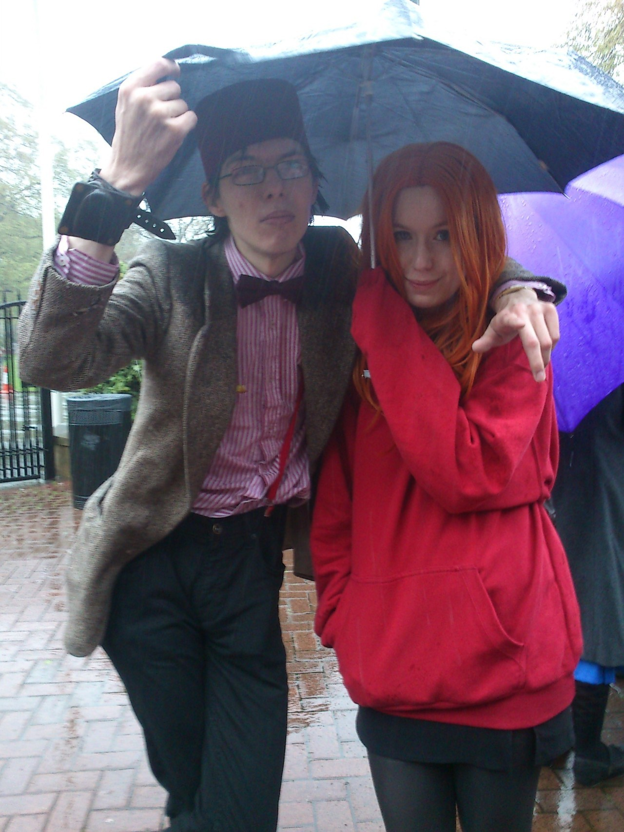 the doctor and amy shelter from the rain during filming in rhyl for the forthcoming series 2012