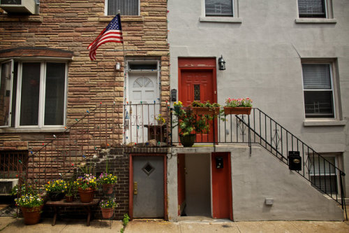 "NYT: On Dennet Place in Brooklyn, a Tight-Knit Community  Dennet Place has also, for the last century or so, been home to a tight-knit collection of Italian-American families that liken the lane to a separate enclave within Carroll Gardens. They call it Cat's Alley, which includes one of the streets bounding Dennet Place, Nelson Street. No one knows how it got that nickname or why the doors are so small. And no one seems to recall a Dennet or know why the name is sometimes spelled with two T's.  …  A few of the old Italian-American families remain, but the lane retains, despite rapid gentrification in the area, a sense of community. People keep copies of each other's keys; they appear unannounced at one another's homes for food and conversation. A local couple was married on the block years ago, and every Memorial Day weekend since at least the mid-1980s, it has been the scene of a block party for the Cat's Alley people. The block party was in full swing on Sunday, with Frank Sinatra crooning from speakers and cones blocking both entrances to the street. Tables were set under a long tent. Joe Dunn, 52, prepared the seafood, Marie DeFiore, 80, the pasta; Michael Mari, 71, and Rocco Scarantino, 54, dubbed by some the mayors of the street, handled the meat. ""When you show up, you know to bring some food and a six-pack of beer at your side,"" said Dee Scarantino, 57, Mr. Scarantino's wife."