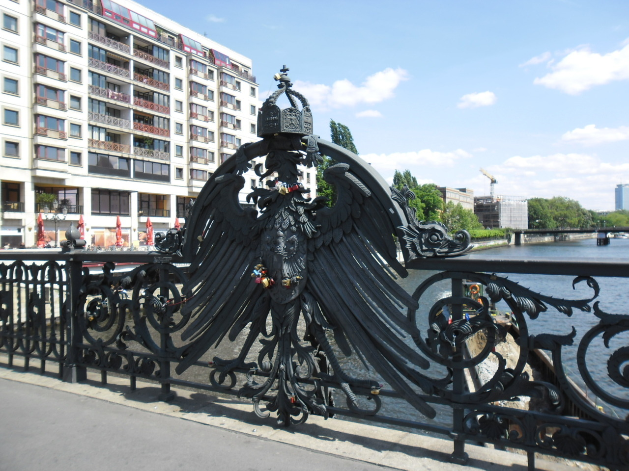 Locks on the Friedrichstraße Bridge over the Spree River in Berlin, Germany. I suspect that they're trying to replicate the Pont des Arts in Paris… (Photos taken by me, 14 May 2012.)
