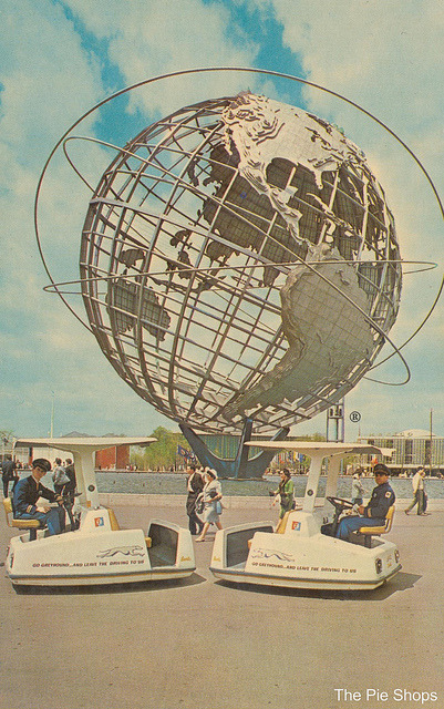 "Unisphere - 1964-65 New York World's Fair Unisphere showing ""Escorters"". These taxis are for hire and hold four persons with driver-guides. The Unisphere is the largest structure in the world fabricated entirely of stainless steel (470 tons were used)."