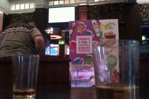 Whiskey, cricket and a fat man in Yates's in Manchester.