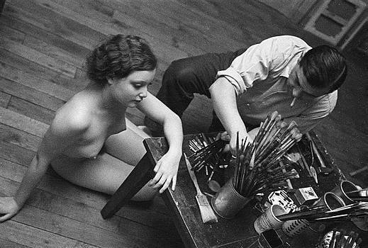 Moïse Kisling (1891-1953), French painter of Polish origin, with model. France, about 1935.
