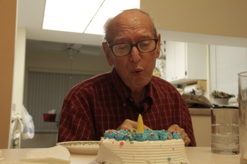 its my grandpa's birthday on wednesday so we got him a cake but there werent any candles so here he is blowing out a corn holder