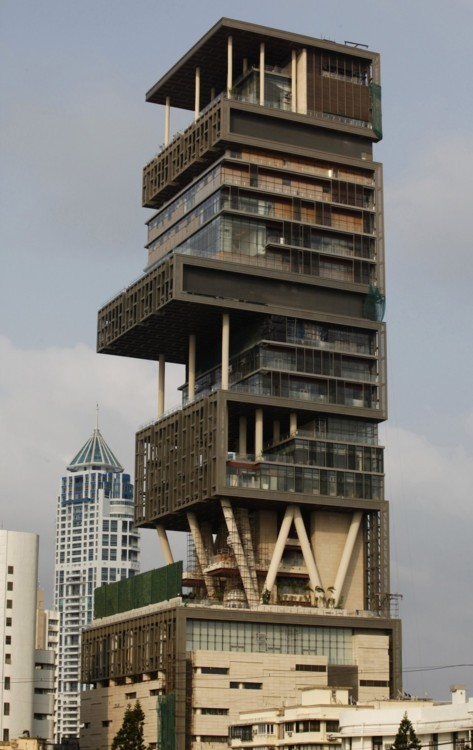 I invite you to check out the world's most expensive house…27 floors for a family of 5, granted they're the richest family in India.  Antilia is the name given to this over-the-top (quite literally) residence, after the mythical island in the Atlantic Ocean. And here are a few numbers: 570 ft. tall 400,000 sq. ft. covering 27 floors 3 helicopter pads 160-car underground parking 600 staff required  And an interior:    Amazing or outrageous???