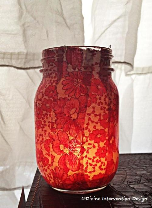 My thrift store mason jar decoupaged with vintage flour sack cloth (tea light inside)