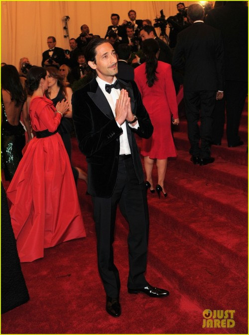 "Adrien had a busy May! First he attended the Met Ball Gala, then he went to Cannes where he allegedly purchased a yacht (who knew endorsing razors and beer brought in that much money) and also presented the Palme d'Or to Michael Haneke. This is him at the Met Ball wearing a velvet tux. A few sources have said it's actually dark blue which means it's perfectly acceptable to hum ""Blue Velvet"" to yourself as you bask in his light. Black or blue, he still looks fabulous."
