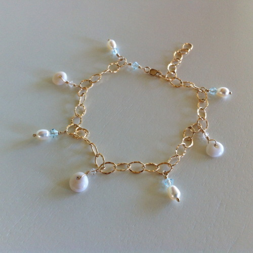 Puka Shell and Fresh Water Pearl Anklet/Bracelet with Aqua Swarovski Crystals  http://www.shellchicmaui.com/collections/bangles/products/puka-shell-anklet-bracelet