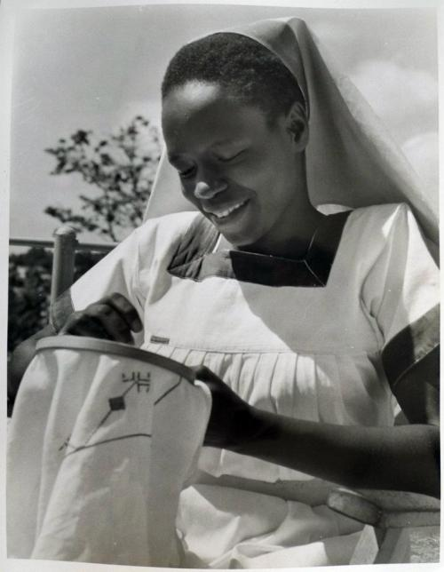 A nurse from Mulago Hospital doing some embroidery, Uganda Via History In Progress Uganda