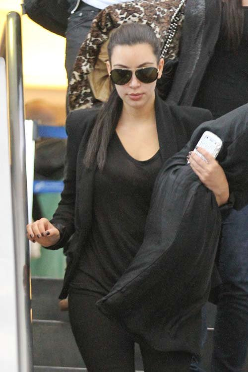 Making an early morning arrival, Kim Kardashian was spotted walking through LAX airport in Los Angeles, CA early this morning (May 28) just in time to spend the holiday with her family. [X]