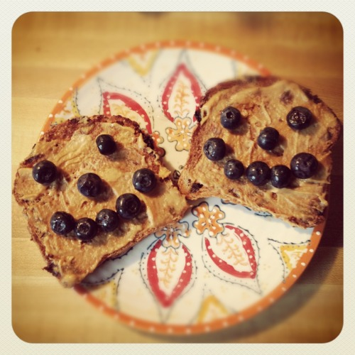 Happy toast! Ezekiel bread with PB2 and blueberries on top - breakfast of champions.