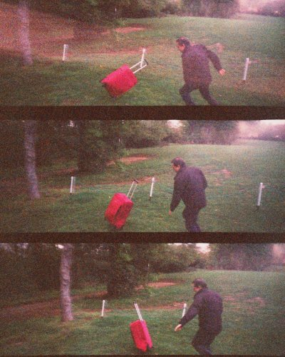 kicking a red trolley on a golf course