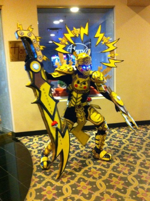 dorkly:  Unbelievably Badass Pikachu Cosplay I don't think mine ever evolved into this.