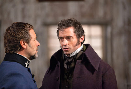 New images from Les Misérables Les Misérables has released a raft of new images, featuring Hugh Jackman and Russell Crowe looking resplendent in their 19th Century get-up.The new images show the two leading men as Valjean and Javert respectively, the former a paroled prisoner in search of redemption, the latter the police inspector who dedicates his life to his re-imprisonment. As their story plays out, the two become embroiled in the June Rebellion of 1832, a conflict that turned Paris into a veritable war-zone…