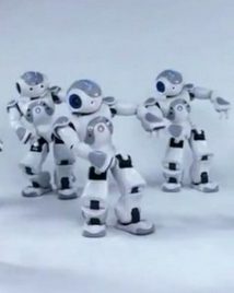 "MIT Researchers programmed a group of humanoid robots from Aldebaran Robotics to dance in unison to Michael Jackson's ""Thriller"" by sensing their environment and coordinating their movements through a central server — rather than trying to awkwardly follow one another directly. This way, even if a robot gets out of step, it can catch up with its peers by communicating with the hub. Bacteria and some insects employ a similar technique called quorum sensing.  Watch the amazing robots that do the 'Thriller' dance in sync"