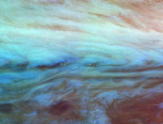 sagansense:  Jupiter: At The Belt-Zone Boundary Credit: The Galileo Project, JPL, NASA Explanation: Jupiter's thick atmosphere is striped by wind-driven cloud bands that remain fixed in latitude - dark colored bands are known as belts while light colored bands are zones. At Jupiter's belt-zone boundaries the shearing wind velocities can reach nearly 300 miles per hour. Near infrared images recently returned by the Galileo Spacecraft were mapped to visible colors in this close-up of a belt-zone boundary near the gas giant's equator. The color mapping reveals different layers, lower clouds are bluish, higher ones pinkish. The smallest features seen are tens of miles across.