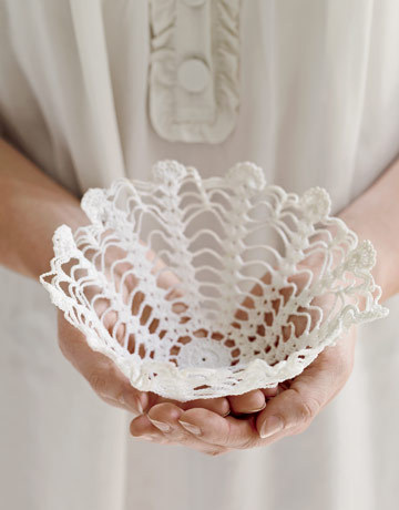 Vintage Doily Basket | Country Living This is a super easy craft - all you need is starch and a doily! I have seen these made using glue and water - good if you want the bowl to be a bit more sturdier and permanent. With the starch though you can just soak it in hot water and voila, you have your doily back!